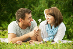 Young man giving a flower to girlfriend Stock Photos