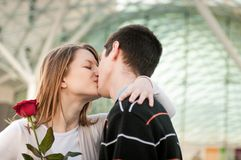 Young man giving a flower to woman Royalty Free Stock Photo