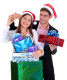 Young man giving a gift a girl in Christmas Royalty Free Stock Photography
