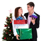 Young man giving a gift a girl in Christmas Royalty Free Stock Photos