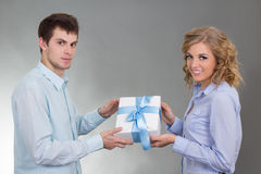 Young man giving a gift to his girlfriend Royalty Free Stock Photo