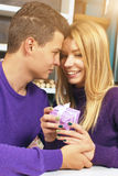 Young man giving a gift to his girlfriend Royalty Free Stock Photography