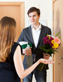 Young man giving gifts to cute woman Stock Images