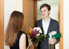 Young man giving gifts to woman Stock Photos