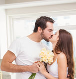 Young man giving girlfriend white roses stock photography