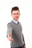 Young man giving hand Royalty Free Stock Images