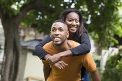 Young man giving his girlfriend a piggyback Royalty Free Stock Photography