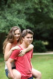 Young man giving his girlfriend a piggyback Royalty Free Stock Image