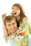 Young man giving his girlfriend piggyback ride Royalty Free Stock Images