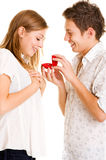 Young man giving his girlfriend ring Royalty Free Stock Photo