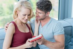 Young man giving his sweetheart a Valentines gift Royalty Free Stock Photo