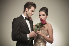 Young man giving his wife a bunch of red roses Royalty Free Stock Images
