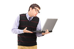 Young man giving a kiss at a laptop computer Stock Images