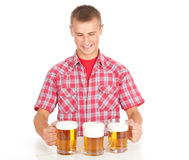 Young man giving mugs of beer Stock Image