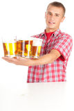 Young man giving mugs of beer Royalty Free Stock Photos