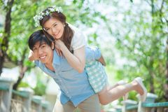 Young man giving a piggy back to his girlfriend Royalty Free Stock Image