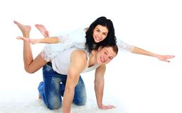young man giving a piggyback ride to her Royalty Free Stock Photos