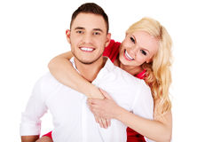 Young man giving piggyback to his girlfriend Royalty Free Stock Images