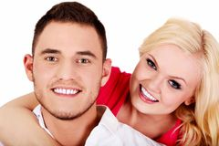 Young man giving piggyback to his girlfriend. Young men giving piggyback to his girlfriend Royalty Free Stock Images