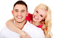 Young man giving piggyback to his girlfriend Stock Photos