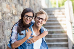 Young man giving piggyback to his woman Royalty Free Stock Photography