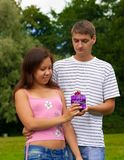 Young Man Giving Present To Girlfriend Stock Photography