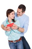 Young man giving present to his girlfriend Stock Photo