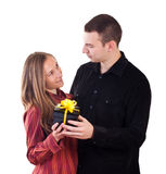 Young man giving a present to woman Royalty Free Stock Image