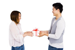 Young man giving a present to woman Stock Images