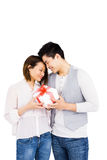 Young man giving a present to woman Stock Photography