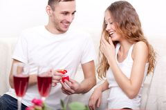 Young man giving ring for his girlfriend Stock Image