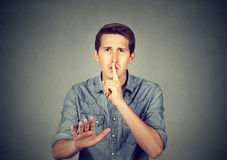 Young man giving Shhhh quiet, silence, secret Stock Image