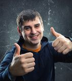 Young man giving thumb up Stock Photos