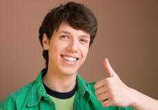 Young man giving a thumbs up Royalty Free Stock Photo