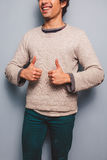 Young man giving thumbs up. Young man is giving thumbs up Royalty Free Stock Photography