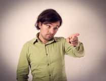 Young man giving thumbs up pointing fingers.  Stock Image