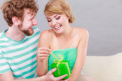 Young man giving woman gift box Stock Image