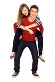 Young man giving woman a piggyback Royalty Free Stock Images