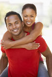 Young Man Giving Woman Piggyback Outdoors Stock Photography