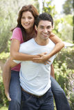 Young Man Giving Woman Piggyback Outdoors Stock Photos