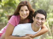 Young Man Giving Woman Piggyback Outdoors Stock Image