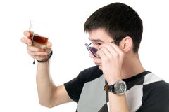 Young man with a glass Royalty Free Stock Images