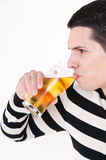 Young man with glass of beer. Drinking Royalty Free Stock Image