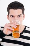 Young man with glass of beer Stock Images