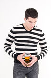 Young man with glass of beer. Thinking Royalty Free Stock Image