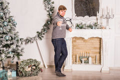 Young man with glass of champagne. Christmas and New Year celebrations Stock Photos