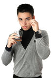 Young man with a glass. Isolated Royalty Free Stock Photography