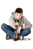 Young man with a glass of whiskey Stock Image