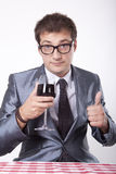 Young man with a glass of wine Stock Photography