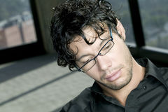 Young man with glasses. Picture of focused young man with glasses Royalty Free Stock Image